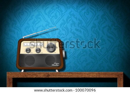 Retro radio on wood table with blue wallpaper background