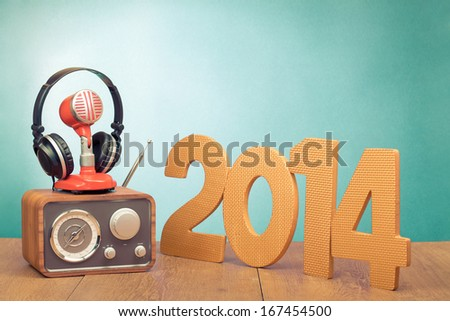 Retro radio, red microphone, headphones and 2014 New Year date - stock photo