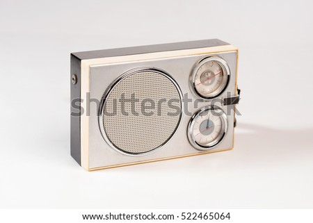 Retro radio with clock on a white background. Isolated