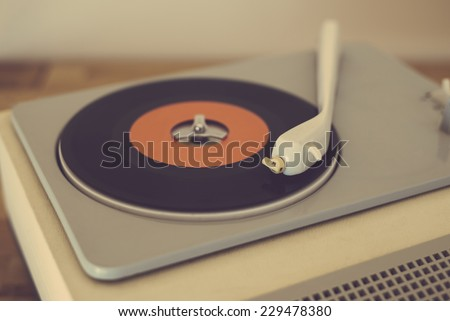 Retro record player from the sixties - stock photo