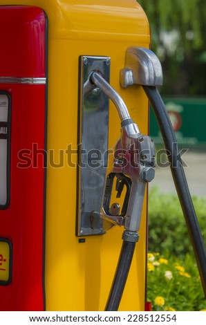 Retro red fuel pump old yellow - stock photo