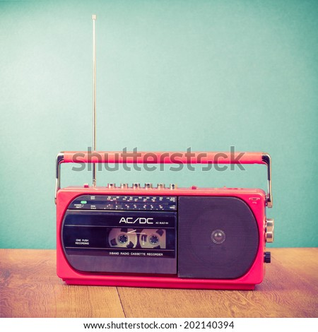 Retro red radio cassette recorder - stock photo