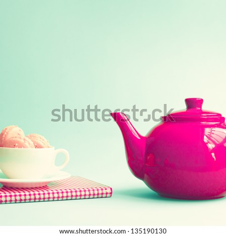 Retro Red Teapot on Mint Background - stock photo