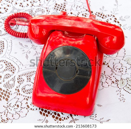 retro red telephone on white pattern cloth background