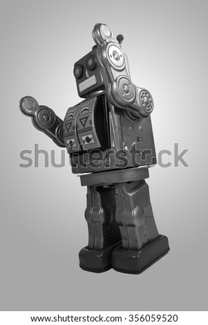 retro robot toy black and white on gray background.