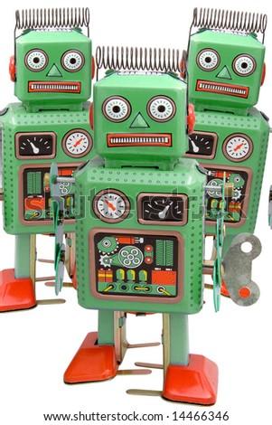 retro robot toys on white - stock photo