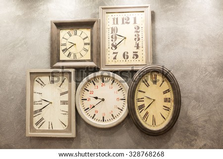 retro room with clocks decorated on the wall - stock photo
