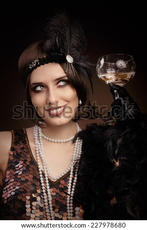 Retro 20s style woman holding champagne glass - Portrait of a flapper girl at a party - stock photo