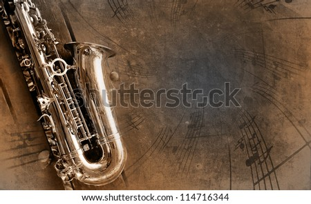 Retro Sax with old yellowed texture background - stock photo