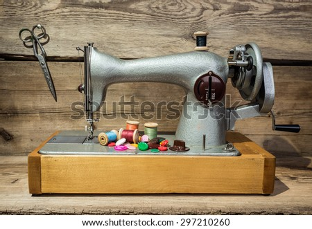 Retro sewing machine on a wooden background