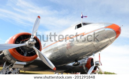 Retro silver propeller airplane nose and engine view - stock photo