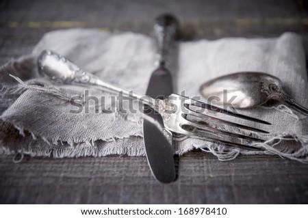 Retro silverware on gray napkin. - stock photo