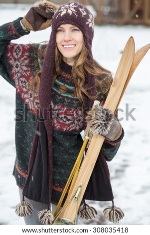 Retro ski woman. outdoors shot - stock photo