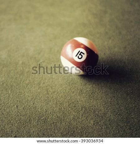 Retro Snooker ball on snooker table - stock photo