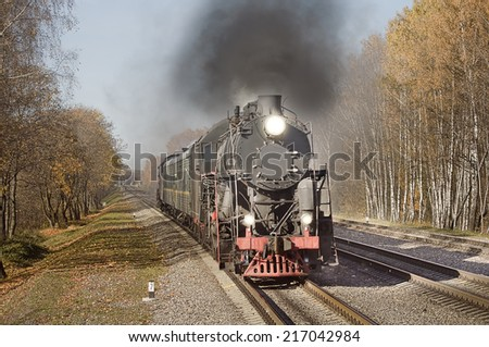 Retro steam train goes fast. - stock photo