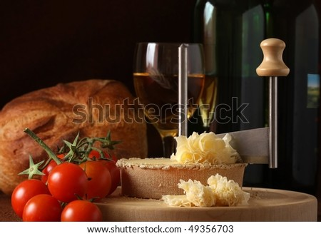 Retro Still life of Swiss Cheese Specialty Tete de Moine in low key tone