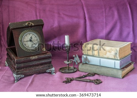 Retro still life with clock,books and candle