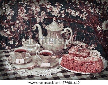 Retro still life with old tea set, sugar, cake and blooming cherry tree, afternoon tea in the spring garden - stock photo