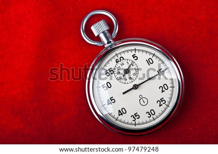 retro stopwatch on a red background - stock photo