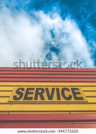 Retro Style Auto Repair Shop Or Garage With Service Sign - stock photo