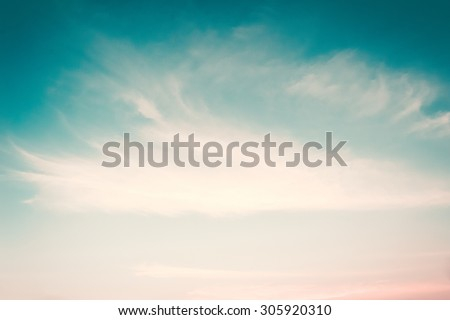 Retro style blurred sky background soft clouds wind movement: Blurred nature background cyan blue cloudy sky in vintage color tone: Heaven hope faith love truth concept: Holiday seasonal retro theme - stock photo