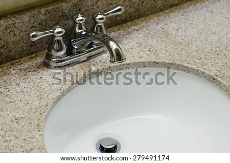 Retro style Chrome Faucet and old sink in bathroom. Selective focus on a tap - stock photo