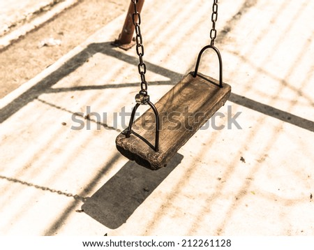 Retro style empty chain swing. - stock photo