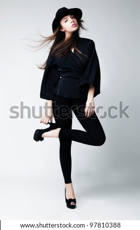 Retro Style. Fashion full Portrait of a Beautiful Young Sexy Woman in Black Clothing - series of photos - stock photo