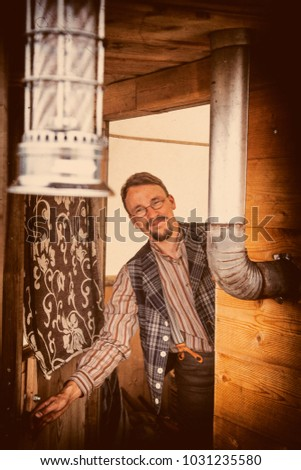 retro style image of a farmer opening the door of his wooden mobile wheel home