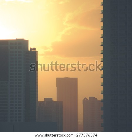 Retro Style Image Of Downtown City At Sunset