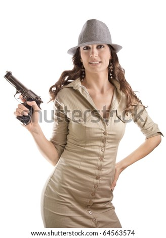 Retro style mafia girl with gun and hat with posing strange expression