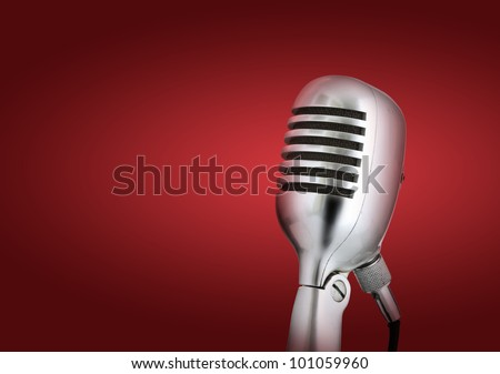 Retro style microphone.Red background