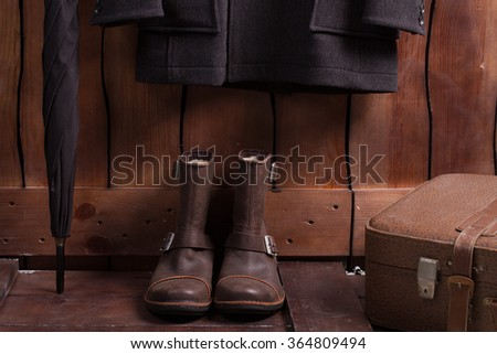 Retro style of menswear. Old clothes and accessories. Men's clothing on a wooden background. - stock photo