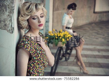 Retro style photo of two young beauties - stock photo