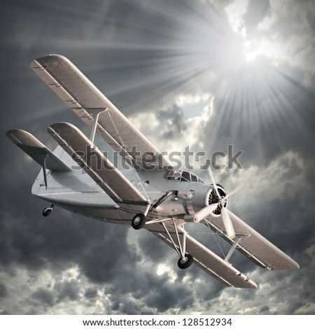 Retro style picture of the biplane. - stock photo