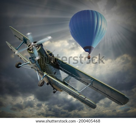 Retro style picture of the biplane and hot air balloon. History of aeronautics concept. - stock photo