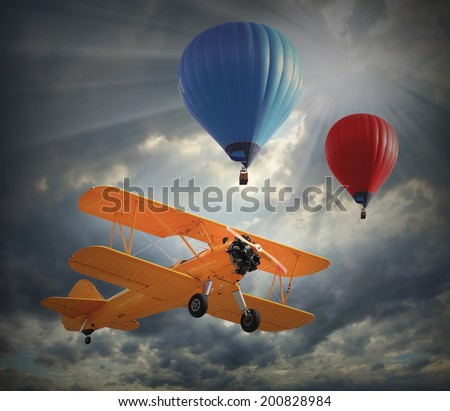 Retro style picture of the biplane and hot air balloons. History of aviation concept.  - stock photo
