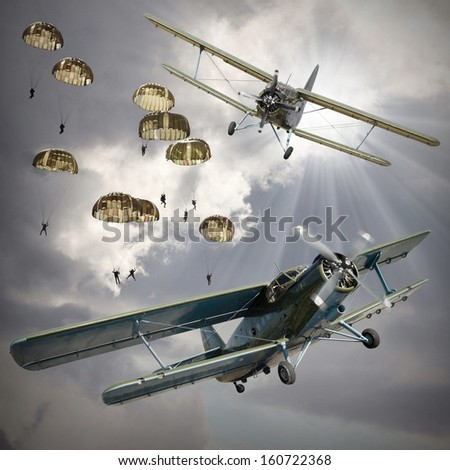 Retro style picture of the biplanes with airborne infantry. - stock photo