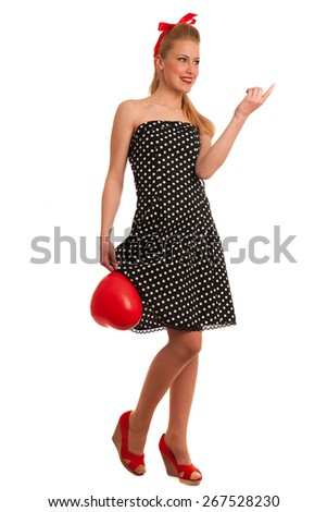 Retro style pin up girl with blonde hair in black dress wtih white dots isolated over white background - stock photo
