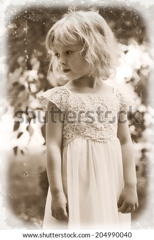 retro style portrait of little girl 3 years old, in soft focus, outdoors - stock photo