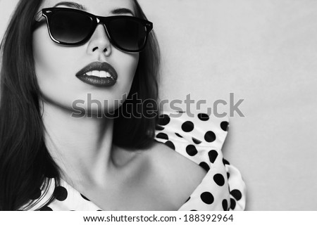 Retro style portrait of young beautiful woman with glasses and long hair - stock photo