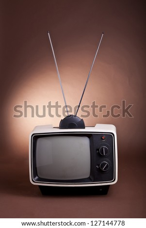 Retro style 70's TV set  with bunny ear antenna - stock photo