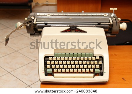 Retro style typewriter at office desk - stock photo