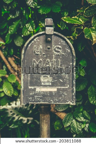 Retro Style Vintage US Mail Post Box Against Lush Tropical Background In Hawaii - stock photo