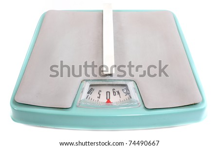 Retro style weighing machine isolated on a white background. - stock photo