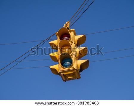 Retro style yellow traffic light. - stock photo
