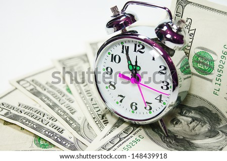 Retro styled alarm clock cover pile of money isolated on white. Time is money concept , dollars, euro  - stock photo