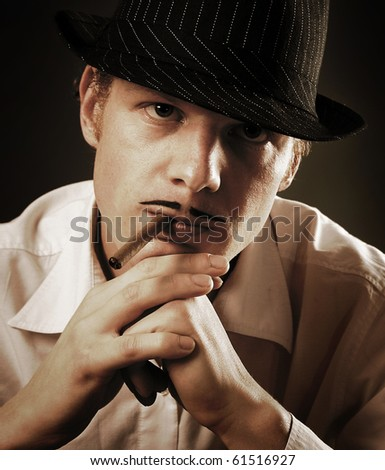 retro-styled gangster smoking cigar