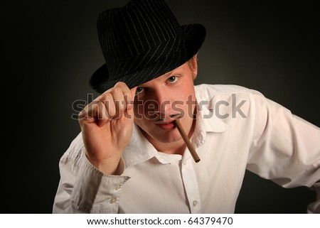 retro-styled gangster smoking cigar - stock photo