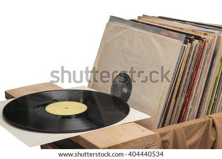 Retro styled image of a collection of old vinyl record lp's with sleeves, solated on white background. - stock photo